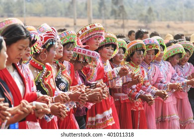 Heqing, China - March 15, 2016: Chinese women dressed with traditional clothing dancing and singing during the Heqing Qifeng Pear Flower festival
