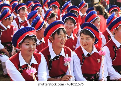 Heqing, China - March 15, 2016: Chinese girl in traditional Bai clothing during the Heqing Qifeng Pear Flower festival