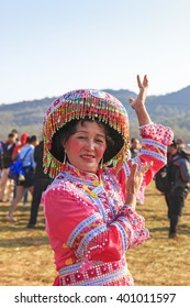 Heqing, China - March 15, 2016: Chinese woman in traditional Miao attire during the Heqing Qifeng Pear Flower festival