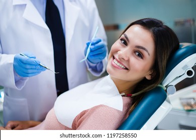 Her amazing smile! Beautiful young woman looking at camera with smile in dentist's office