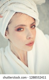Her haircare routine. Beauty routine and hygiene care. Pretty woman wear bath towel on head. Young woman in bathing gown. Skincare model after spa bath. Skincare at spa. Beauty salon. Bathing habits.
