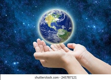 her hand a glowing earth globe, Elements of this image furnished by NASA