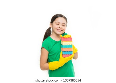 Her kitchen sponges. Little housemaid ready for household help. Small housekeeper holding dish sponges in rubber gloves. Adorable kitchen maid. Household duties. Cleaning and washing up.