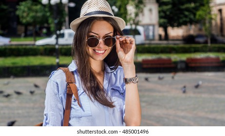 Her sunny smile brightens any day. Portrait of an attractive young woman in a sunhat standing outside.