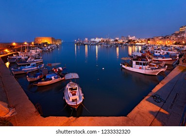 """HERAKLION CITY, CRETE ISLAND, GREECE- August 26, 2008. The old Venetian castle known as """"Kule"""" at the entrance of the old harbor of the city."""