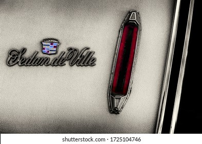 Heraklion, Creete / Greece - Jul 6, 2013: Detailed view of a Cadillac Sedan de Ville 1970's model logo with the red fog light reflector. Background use, conceptual image, illustrative editorial