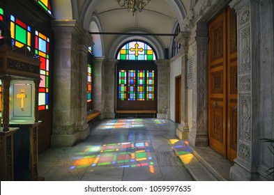 Heraklion, Crete / Greece - April 3, 2012: The Agios Minas Orthodox Cathedral. Sun passes through the stained glass windows creating colorful reflections on the floor of the church's vestibule