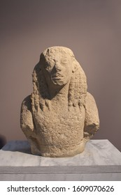 HERAKLION, CRETE, GREECE - AUGUST 1, 2016: Upper body of a Daedalic statue of Kore made of poros stone, belongs to Archaic Period 7th cent B.C. at the Heraklion Archaeological Museum.