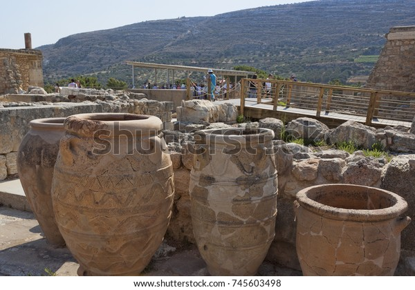HERAKLION, CRETE, GREECE - AUGUST 1, 2013: Ruins of Knossos Palace, in the foreground, the pithos are large ancient Greek jugs, vessels for storing food - grains, wine, olive oil, salted fish.