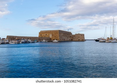 Heraklion, Crete/ Greece - March 20th 2018: view of the boats at the port and the venetian fortress