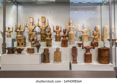 HERAKLION, CRETE, GREECE-JUNE 05, 2017:Clay figures of goddesses with raised hands of the Minoan civilization in the archaeological Museum of Heraklion. Crete, Greece
