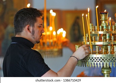 Heraklion, Greece, 25 September 2018, A person lights candles in the cathedral of Agios Minas (Saint Minas) in Creete