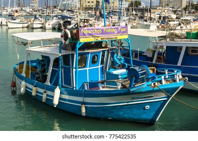 HERAKLION, GREECE - November, 2017: colorful greek fishing boats near old Venetian fortress Koule, Heraklion port, Crete