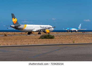 HERAKLION / GREECE - SEPTEMBER 2017 Thomas Cook Airbus A321, OY-VKC taxiing to the taxi holding position for departure back to scandinavia while TUI (Thomson Airways) Boeing 757, G-CPEU just landed.
