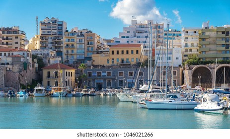 HERAKLION, GREECE - SEPTEMBER 22, 2017: boats and yachts in old Venetian Harbour in summer sunny day (panorama view)