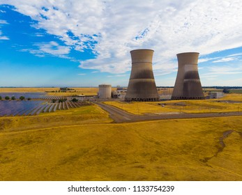 HERALD, CA, USA 0 JUN 5, 2018: Rancho Seco Nuclear Power Plant cooling towers above solar panels plant