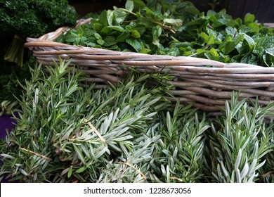 Herb basket with fresh peppermint and rosemary