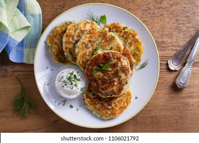 Herb and Cheese Mashed Potato Cakes. Potato Pancakes. Vegetable fritters. View from above, top studio shot