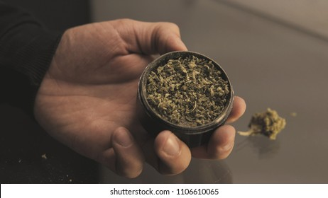 Herb Grinder close-up. Weed grinder for smoking joints & blunts