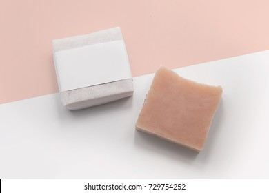 herb handmade soap in package with two tone background. closeup.