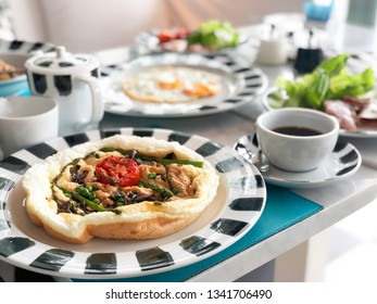 Herb omelette with chives and oregano sprinkled healthy breakfast