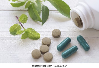 herb pill on top view of wood table and copy space