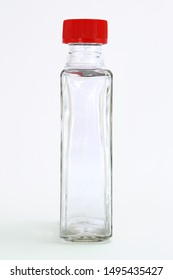 Herb pot spices pot bottle glass red cap single blank isolated white background freshness clean water studio mineral purity side view neutral customizable hrb herbs spice pepper Crystal food