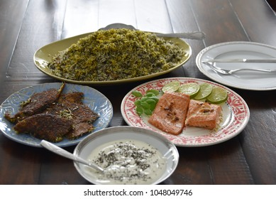 Herb rice and fish, aka Sabzi Polo Mahi, is the traditional dinner for Iranian new year eve.
