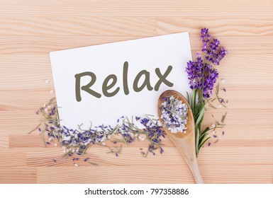 Herb salt with rosemary, lavender and card with text: Relax