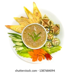Herb soya bean paste chili spicy with coconut milk with fresh carving vegetable Thai cuisine,Thaispicy healthy food or dietfood side view  isolated on white background