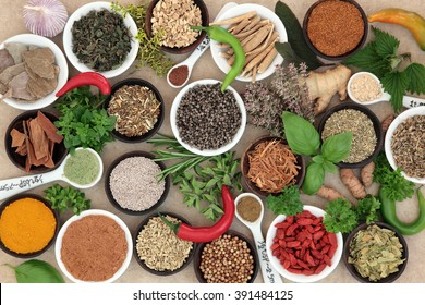 Herb and spice selection used in cooking and in natural alternative herbal medicine for mens health on hemp paper background.