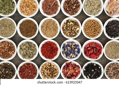 Herb teas in china bowls forming an abstract background. Teas used in natural alternative herbal medicine.