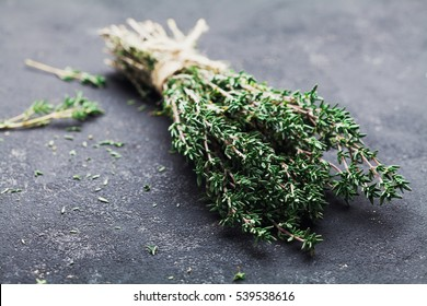 Herb thyme on black kitchen table closeup.