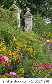Herbaceous Flower Border within an Old Fashioned Walled Garden with Grand Stately Entrance