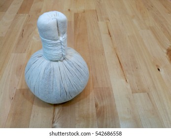 Herbal Ball Tool for Thai Traditional Body Massage Treatment on the Wooden Table Wooden Background