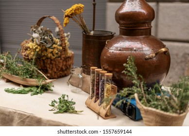 Herbal bench and old copper essential oil distiller