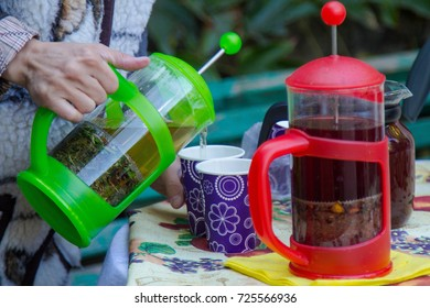 Herbal and berry tea is poured on the street market