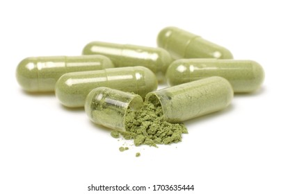 Herbal capsules, andrographis Paniculata capsules and powder isolated on a white background,Close up.