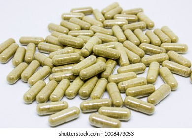 Herbal capsules on a white background.
