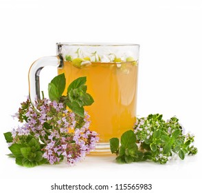 Herbal chamomile tea with origanum and mint isolated on white background