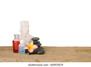 Herbal Compress , Herball Ball,Frangipani flower,stack stone,shampoo and Liquid soap spa style on wood with copy space and  white background