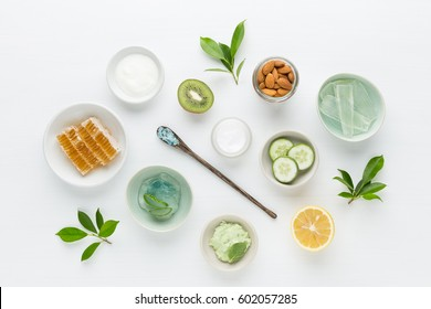 Herbal dermatology cosmetic hygienic cream for beauty and skincare product. honey, lemon, almond, kiwi, cucumber, aloe vera, salt, yogurt on white background.