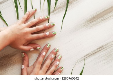 Herbal design on short nails.Striped manicure of nature.Nail art.Adult and children's hygienic manicure.