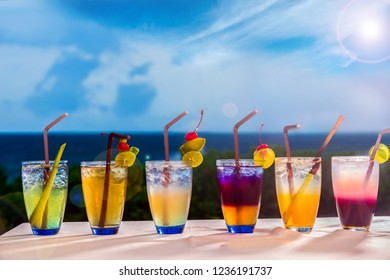 Herbal drinks, Many kinds of 6 Herbal Beverages on the table by the sea with blue sky.copy space