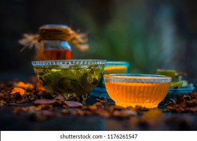 Herbal face pack of aloe vera ,turmeric,rose water, and honey for glowing and Radient skin and for all skin types all the ingredients on wooden surface,Close up view.