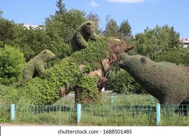 Herbal green landscape composition Dipper and bears. Russia, Krasnoyarsk, Metallurgov Avenue, June 24, 2017