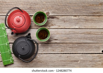 Herbal green tea and teapots. Top view with space for your text