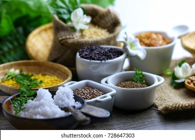 Herbal and healthy food mania of many dry food ingredient on sack table , added superfood like flower sea salt, flax seed and perilla for food aromatic product lifestyle