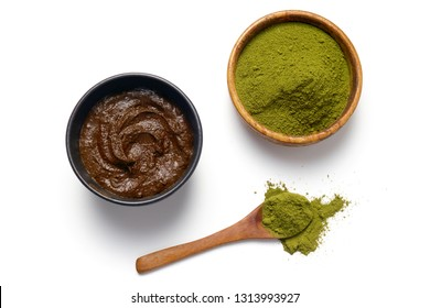 Herbal Henna powder and henna paste on white background.