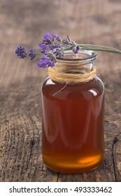herbal honey in jar with fresh flower